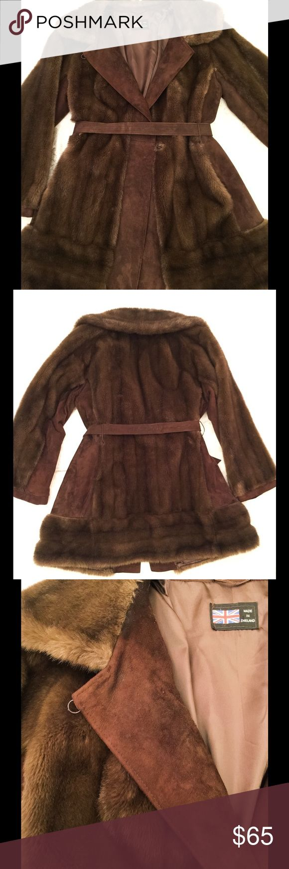 Faux Fur and Real Leather Coat Made in England, this sophisticated coat is sure to add style to your winter trip abroad or your yearly family outing to see the Christmas lights. It is soft and comfortable, but has a leather belt to cinch the waist and show off your curves. Great condition! London Leathers Jackets & Coats