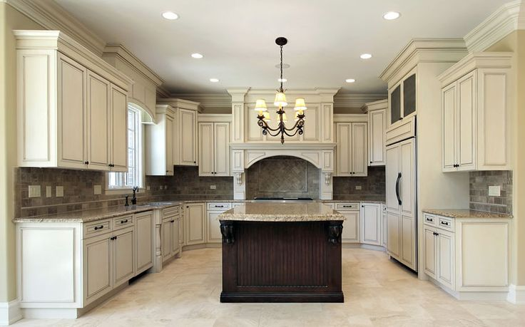 U shaped kitchen with antique white cabinets