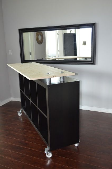 Moveable counter space.... Ikea Hack - standing desk // kitchen island // drink + food bar in dining room