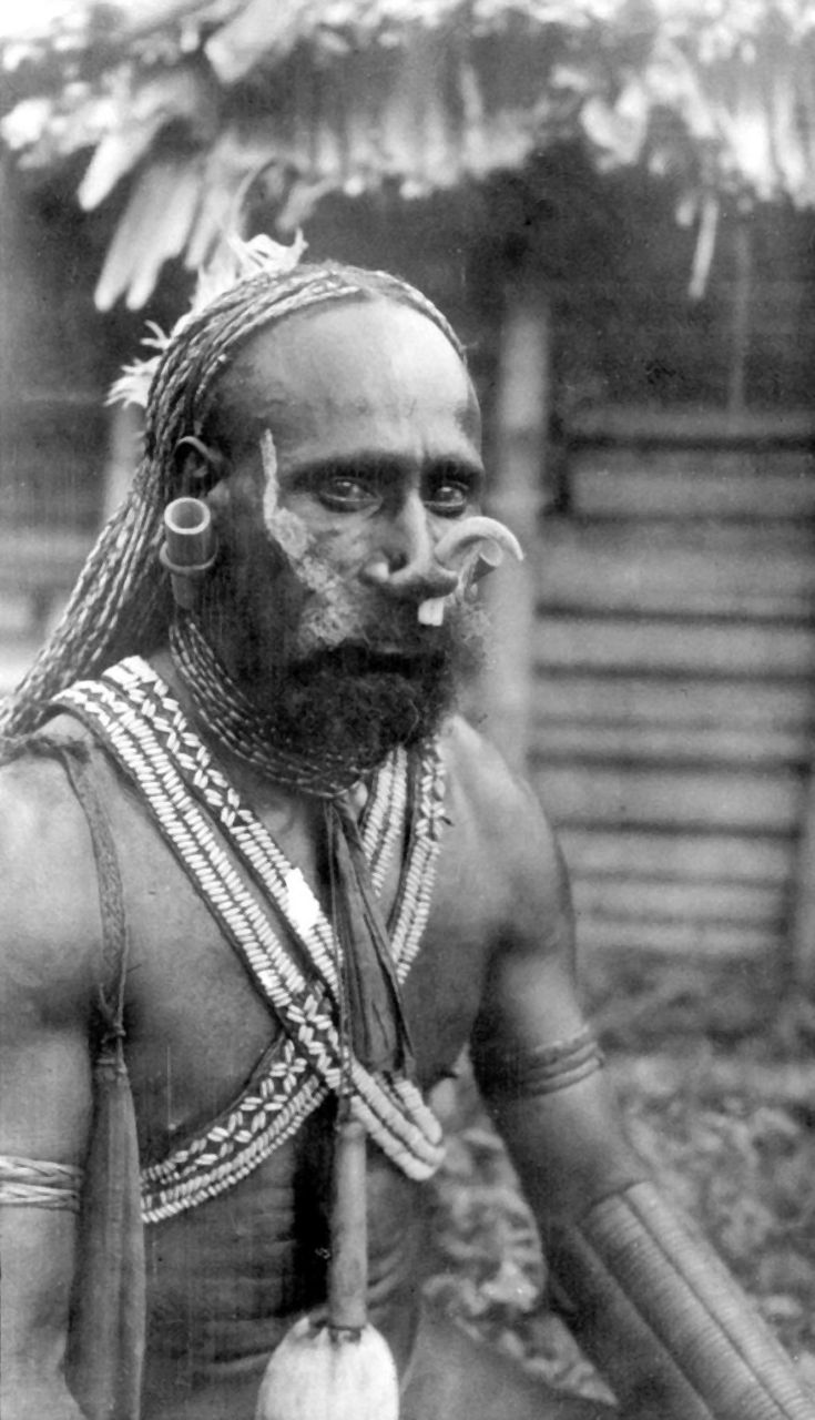 Papua (Indonesia) | Portrait of a Marind Papuan man | Marind, Merauke Regency | ca. 1925.  Photographer unknown