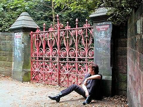 John at the gates of Strawberry Field