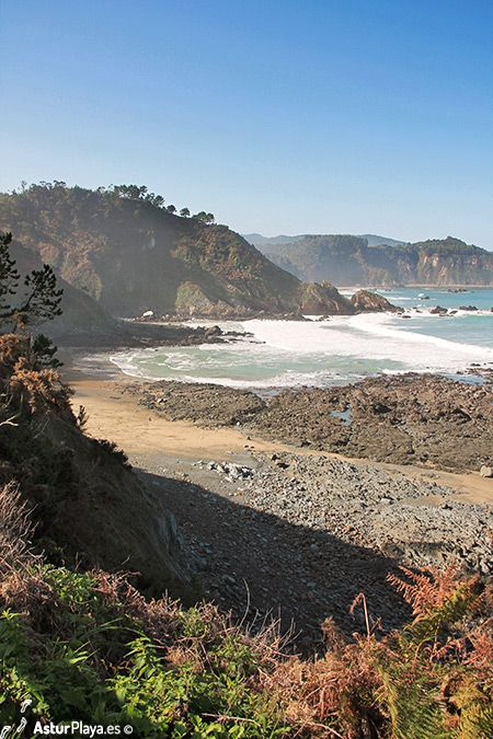 Western side of Las Llanas beach in Muros de Nalon, Asturias (north of Spain).  A bit changed after the torments washing the sand away during the spring of 2014, but beautiful nonetheless.