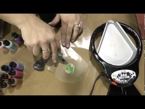 This is a demo of embossing metal shapes to get an impression. She shows how to add rich coloring to them with lots of depth. Next she shows how to relief the metal so some of it shows through the color. And finally, she demonstrates melt art with a melting pot to give the metal an amazing shiny covering, or a thick raised matte finish