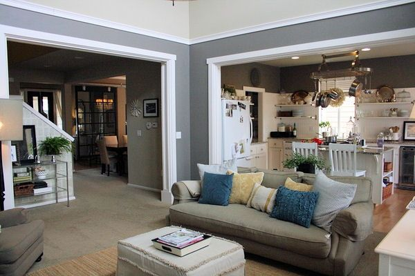 cool way to repaint a room with double-height ceilings -- add crown molding and paint a different color below the molding.