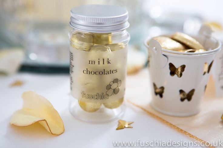 Wedding favours. Milk chocolate candy jar and butterfly favour pails filled with heart chocolates.  www.fuschiadesigns.co.uk