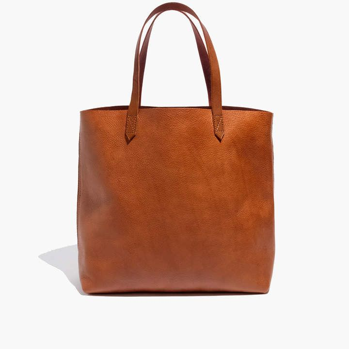 Madewell The Transport Tote. Here it is by the numbers: 2 pieces of fine leather are used for the body. 8 inch strap drop: long enough to sling over your shoulder, but short enough to hold as a top handle