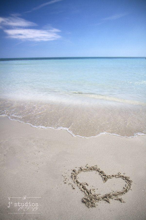 Caribbean Love is an art print of a heart in the sand on a beach in Cuba.