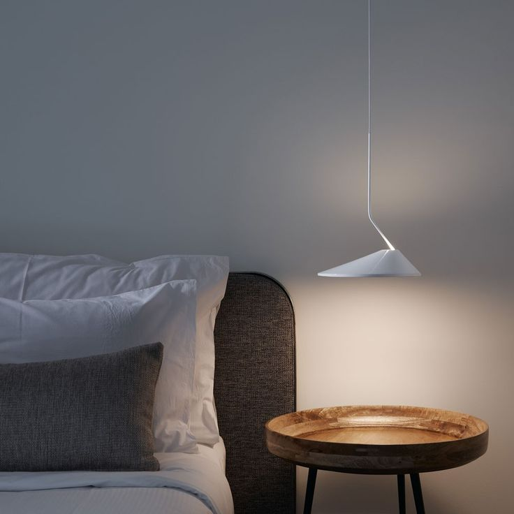 As a rule of thumb, pendants are usually suspended anywhere between 28-36 inches above the target surface. http://www.ylighting.com/blog/pendant-lights-101/