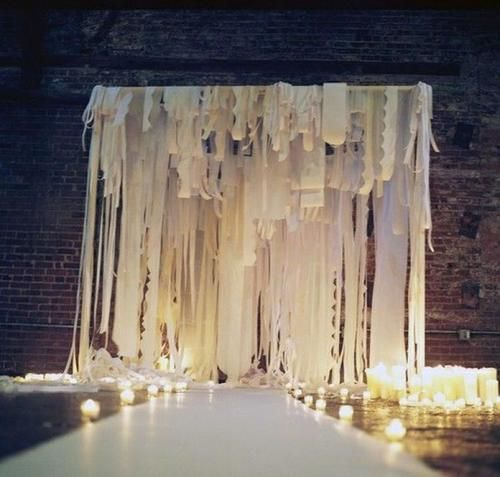 Ripped fabric ribbon backdrop via Once Wed.