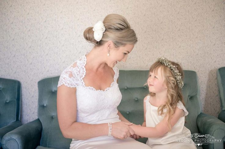 Special and happy moment between a bride and her flowergirl. Check out other wedding photography by Anthony Turnham at www.snapweddingphotography.co.nz