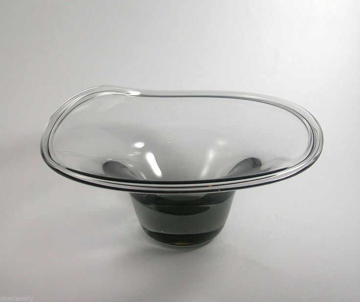 From our ebay site 'Em's Eclectic Emporium'- Vintage Vicke Lindstrand Kosta Art Glass Bowl. Made from a clear smoke Grey glass it has a beautiful free form wave to the bowl edge. Signed to the base.