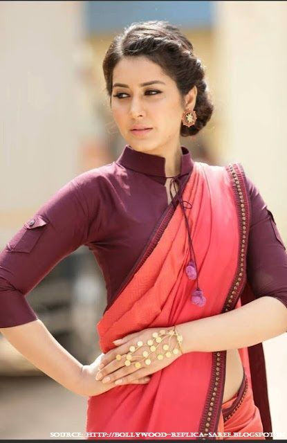 The deep #purple high collar blouse, a functional sleeve matched with a cool cotton saree by #RashiKhanna, emphasizes the fact that contrast looks good and simplicity rocks.