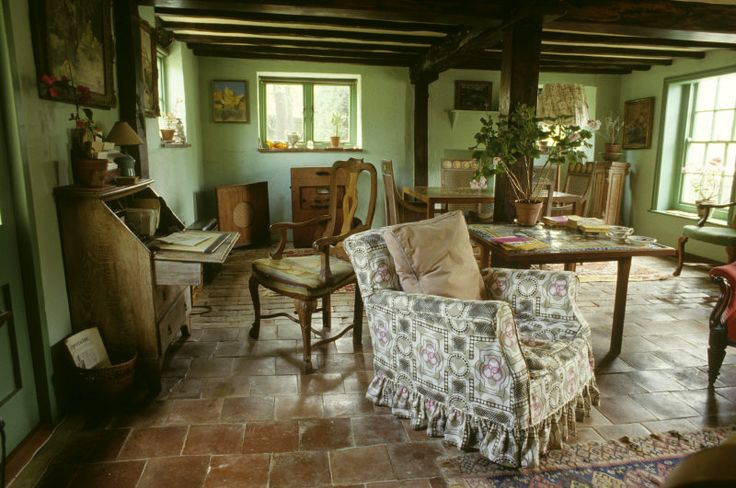 The Sitting Room at Monk's House. The armchair was one of Virginia Woolf's favourite reading chairs. It is upholstered in a fabric designed by her sister, Vanessa Bell. ©NTPL/Eric Crichton