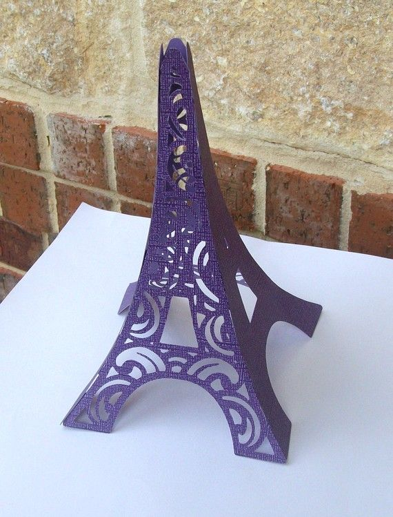 What a cool use of purple and card stock!  have some in different sizes and use them on a mantel, table center piece, or dresser! 3D Eiffel Tower Table Centerpiece in Purple by paperpixie on Etsy, $6.50