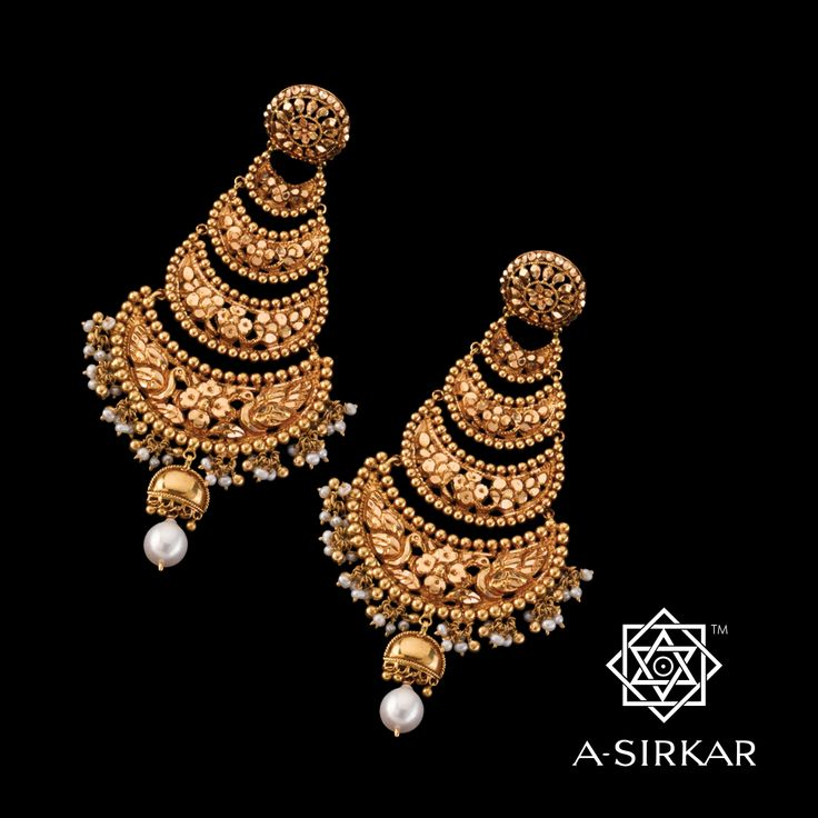 Mayurpur Earring : A four-step jhapta style pure 22K gold earring that's matched to the Mayurpur Necklace but is quite capable of carrying the evening all by itself. The riveting centerpiece of the har is repeated here in a dramatic cascade of naksha crescents that culminates in a generous pearl and ball fringe, with a half jhumka and single oversized pearl drop as a fitting epilogue. You can wear just the earrings ---- they're lavish, and stunning. You deserve to be centre stage.
