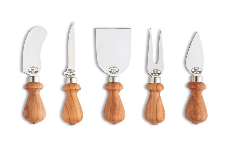 """""""An Italian handcrafted set of cheese knives made in high-carbon forged steel with heritage olive wood handles."""" Cotlellerie Berti's Picolli cheese knife collection is the perfect combination of tradition, technical appreciation, and design for effortless use. High-carbon steel forged by hand resists rust and is held in a mediterranean olive wood handle. The fork, heart, soft-cheese, spatula, & bell knife provide a complete experience of any cheese variety or combination. Handmade in…"""