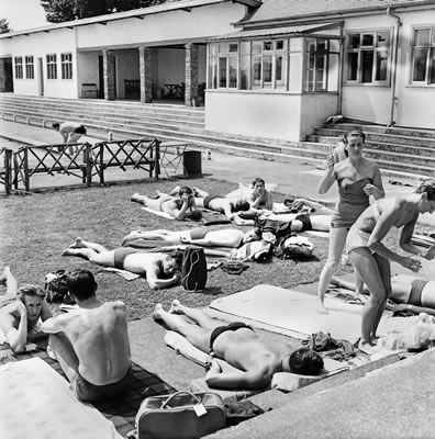 Holidaymakers enjoying the hot weather over the Whitsun Bank Holiday at the Galleon Pool, Didsbury, Greater Manchester. June 1960 #Vintage #Classic #Old #Retro #Historic #OldFashioned #Manchester #MCR #NorthWest #photos #photographs #pictures #images #prints