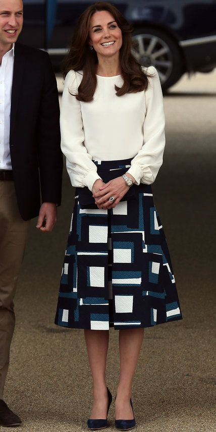 To launch the Heads Together Campaign in London with Prince William and Prince Harry, the duchess wore a cream blouse, a patterned Banana Republic skirt, and navy heels. She even put on boxing gloves to promote the benefits of physical activity for mental health.
