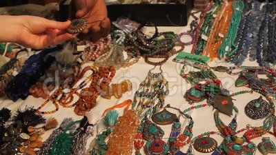 Buyer shopping for jewelry and seller.
