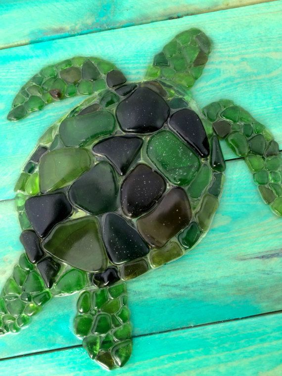 Sea Glass Art - Handmade Sea Turtle Sea Glass Mosaic  Every sea glass mosaic is an original, one of a kind piece made with real sea glass that Ive hand picked along the Pacific coastline. All sea glass is entirely authentic from the beach, and has never been machine tumbled or cut.  I use all repurposed wood for my backgrounds - mostly old fencing reclaimed from yards around my Southern California home.  Once Ive prepped the wood, I hand paint the piece, then mosaic over the painting using…
