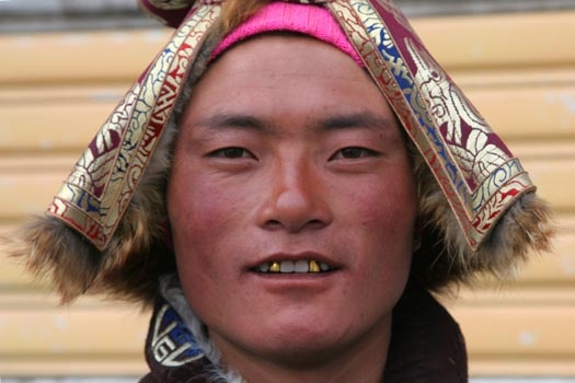 Tibetan man. I want gold teeth like his so bad!