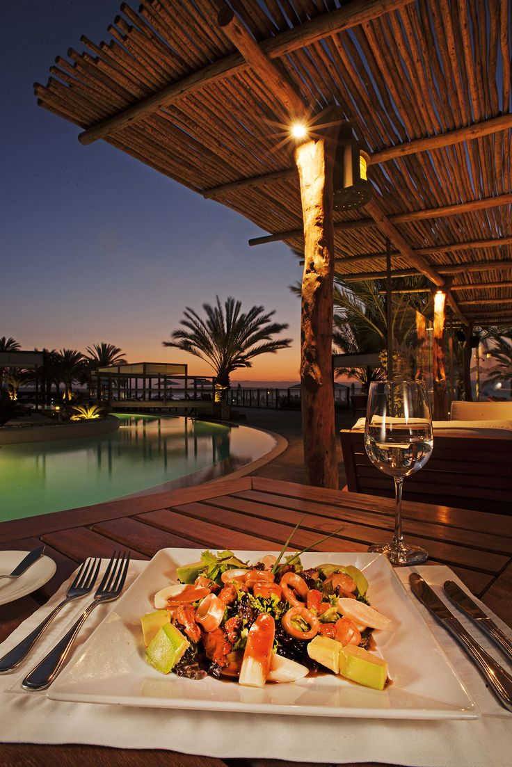 Enjoy our exquisite menu from a dining room decorated with one of the largest selections of seashells in the world, with stunning views of the bay. As experts on the importance of culinary experiences in a country as diverse as Peru, we have created a menu that will surprise you, by blending the most select techniques of international cuisine with our best ingredients. Alongside one of the richest oceans on the planet, our cuisine ensures excellent quality fish and seafood to treat our…