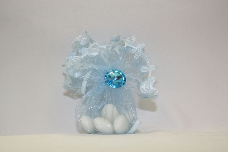 Tulle Pull Wrapper in Baby Blue Decorated -Our decorated tulle wrappers can come with a beautiful 14mm round rhinestone, a 14mm flat back pearls or an acrylic flower -Rhinestones, flowers and pearls come in various colors -Decorated Wrapper also comes with 5 Jordan Almonds, which signifes five wishes for the bride and groom: health, wealth, happiness, fertility, and longevity.  #favor #pouches #bonbonniere #wedding #baptism  #babyshower #decor #candy #Jordanalmonds #blue
