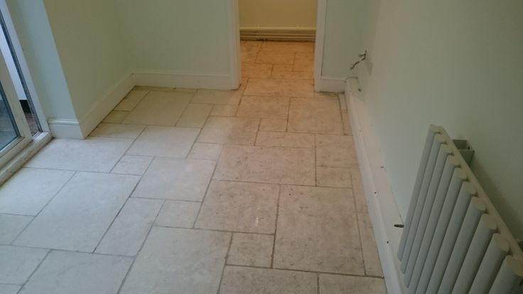 A partially cleaned Limestone Floor. Soil gradually being removed