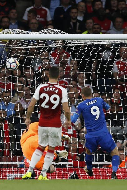 Leicester City's English striker Jamie Vardy scores their second goal past Arsenal's Czech goalkeeper Petr Cech during the English Premier League...