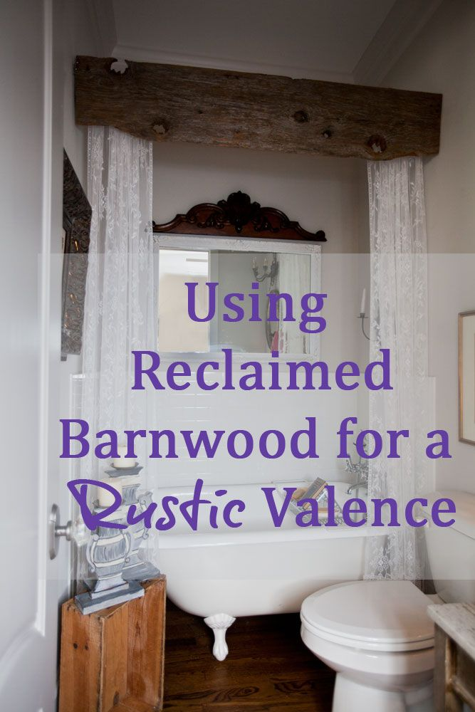 Reclaimed Barn Wood - used to create a rustic valance in the bathroom + Salvaged Pediment - placed over the top of the wall mirror - via Cedar Hill Farmhouse