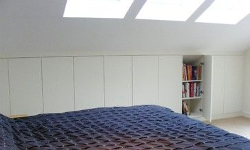Brian and Michael: Concealed book shelves modern bedroom