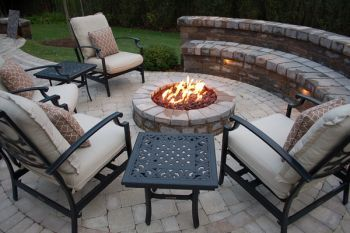 Cast aluminum chairs with wood burning fire pit