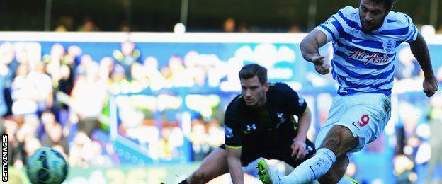 Charlie Austin strikes a shot against the crossbar for QPR