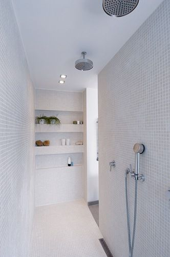 Gorgeous white/grey walk-in shower with mosaic tiling and recessed shelving. Lovely.