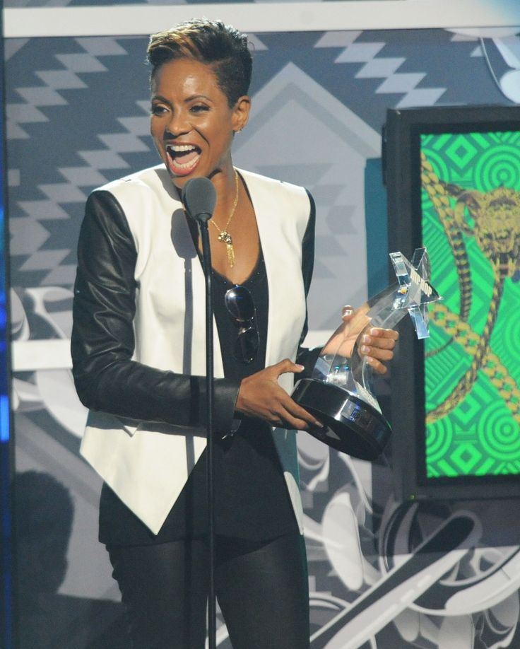 """You love me, you really really love me."" Recording Academy Trustee MC Lyte accepts the I Am Hip Hop Award at the 2013 BET Awards on Sept. 28 in Atlanta: Photo"