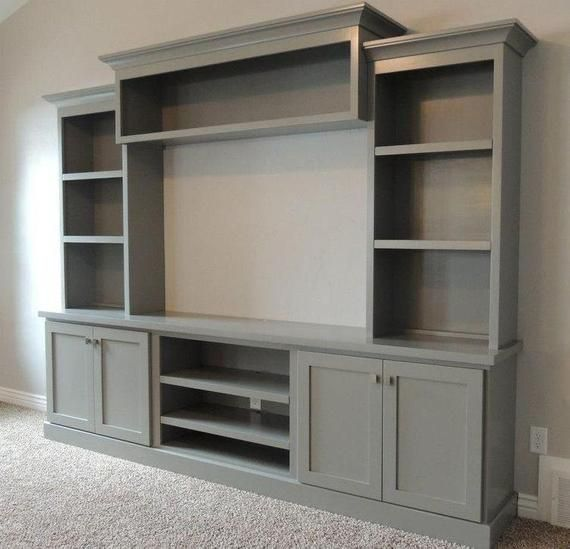 A custom entertainment system that accentuates your home design. The entertainment system is handcrafted in rich wood and painted a dark grey color. I…