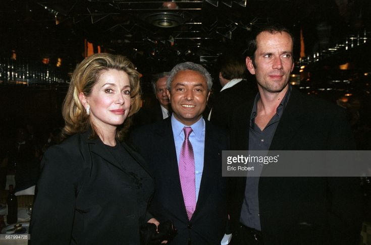Catherine Deneuve, Francois Benaceur, and Christian Vadim attend a benefit party for the Association pour la Vie Espoir contre le Cancer (A.V.E.C.) in Paris. The fundraiser is being held in honor of director Roger Vadim, who died of cancer in 2000. Christian Vadim is the son of Catherine Deneuve and Roger Vadim.