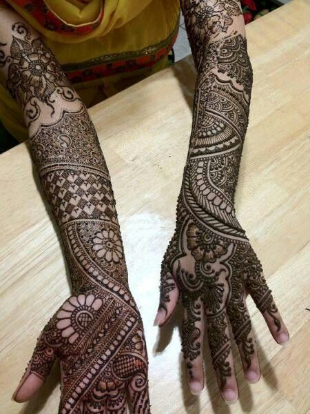 Floral or round motif mehndi designs in the hands