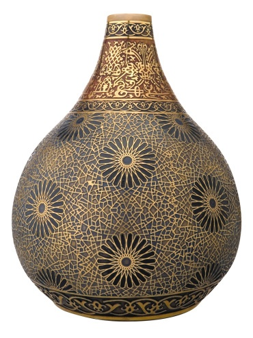 A beautiful vaze made by the Turkish glassware company Pasabahce. The geometric patterns are inspired by the patterns in the Karatay Madrasa in Konya, Turkey.