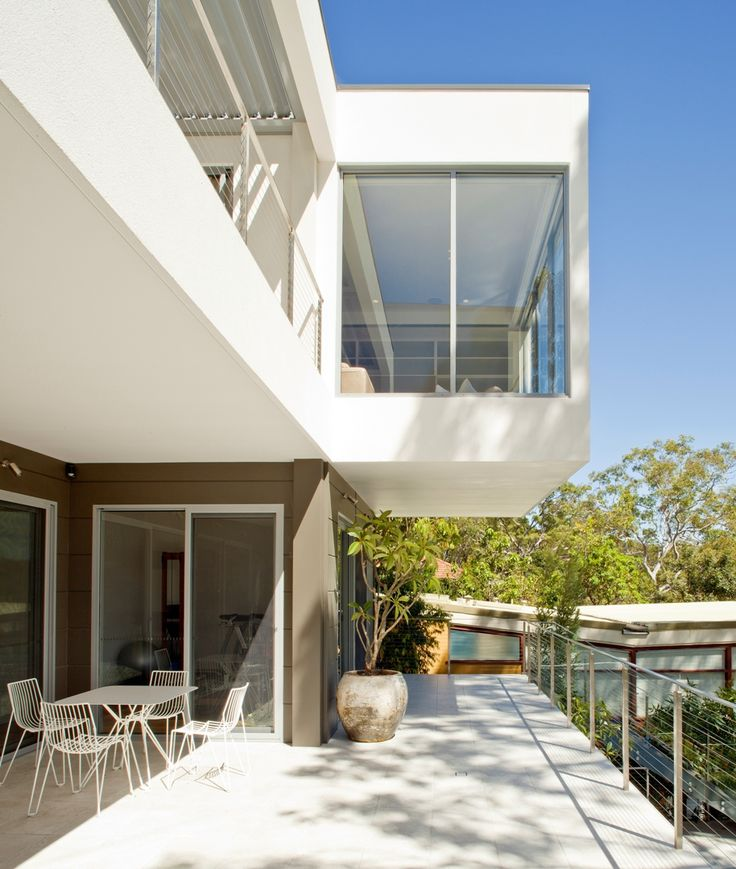 Cantilevered lounge room in white, recently completed in Sydney harbourside residence