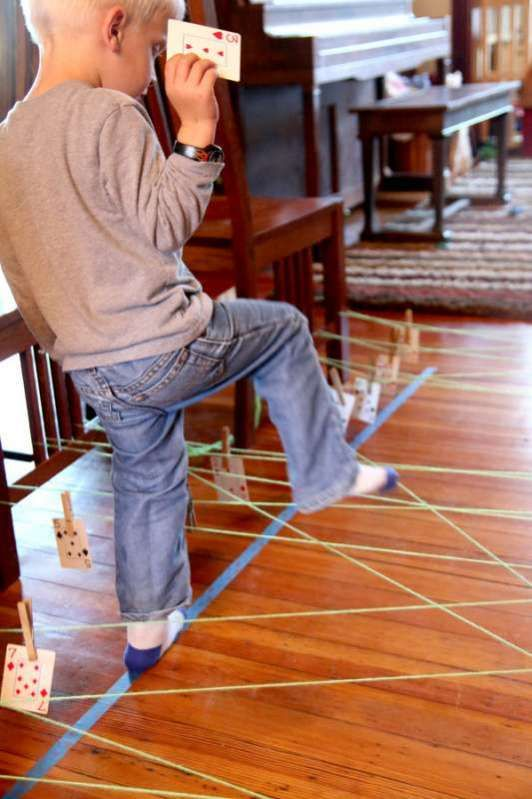 Add learning to an indoor obstacle course for kids that has them climbing on the table and chairs. It's fun when Mom says it's okay to break the rules!
