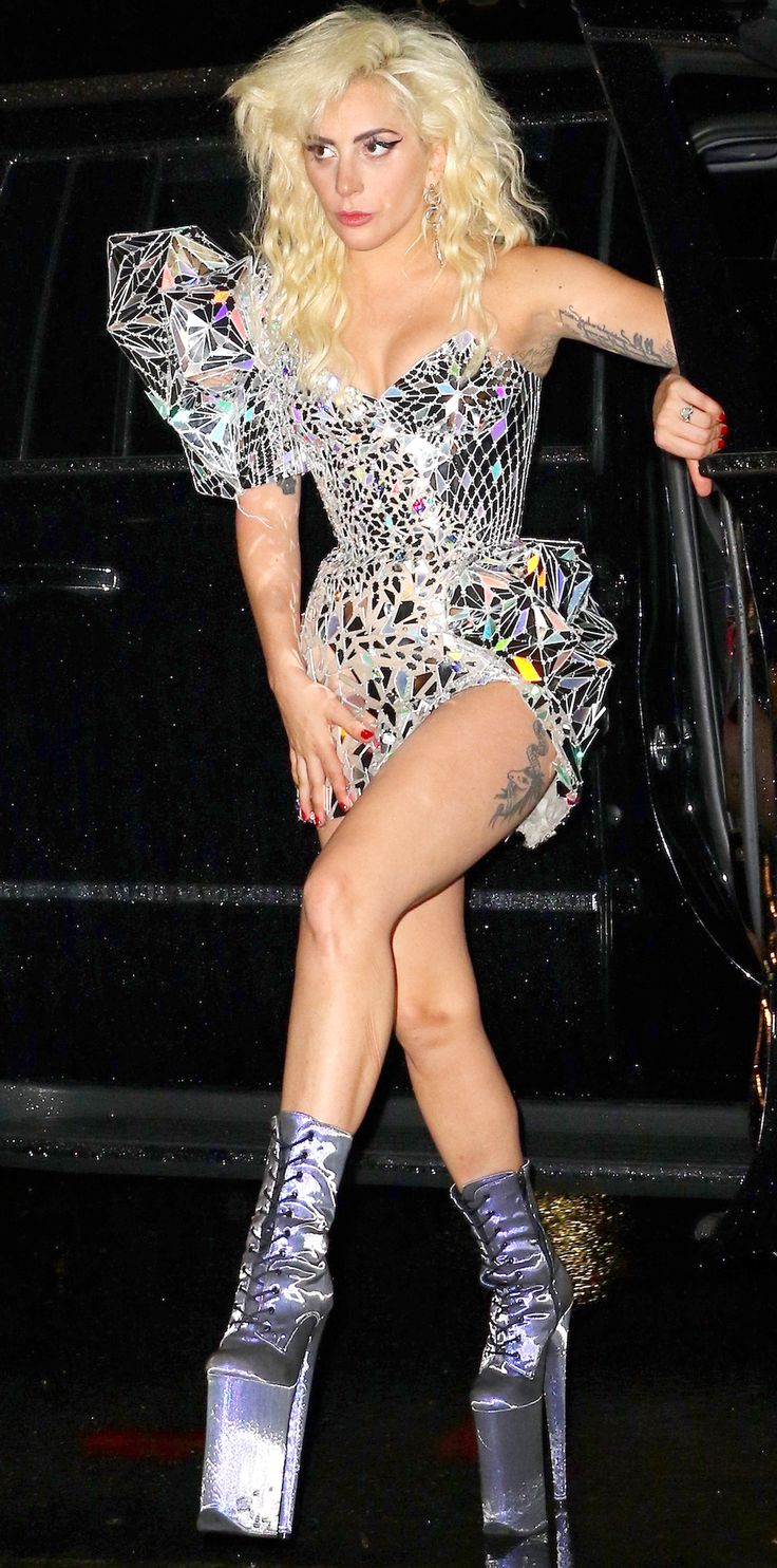 """For the Met Gala after-party, Lady Gaga gave us a major fashion flashback moment when she was snapped in an Atelier Versace mini embellished with mirrors and a Swarovski crystal sculpted shoulder and hip piece that harked back to her """"Just Dance"""" days."""