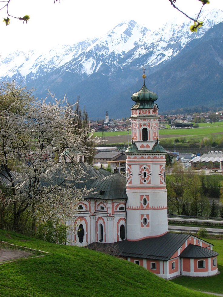 This picturesque church in Hall (Tirol, Austria) was built in 1654 and is  sourrounded by beautiful snowy mountains and green meadows. #feelaustria