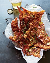 Chicken Crisps Recipe on Food & Wine - Crispy chicken skins are even better than fried pork rinds. At Yusho in Chicago, chef Matthias Merges bakes them until crackly, then tops them with sweet-and-salty seasonings.