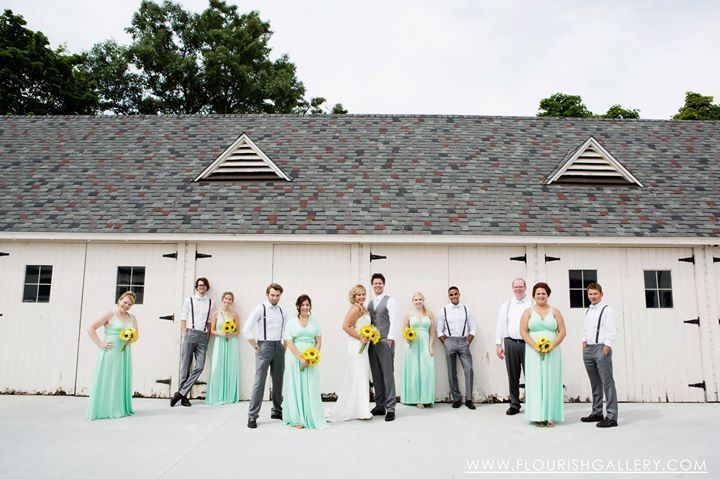Great wedding image in front of the Carriage Garage at the Packard Proving Grounds!  Photo by Flourish Photography
