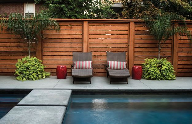 Jenks Fence Co. installed this cedar fence with horizontal slats, adding to the contemporary setting. The new homeowners made sure to add a pool and hot tub when they moved into the modern manor.