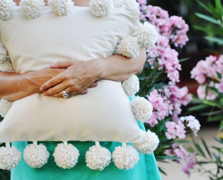pillow with pom pom trim