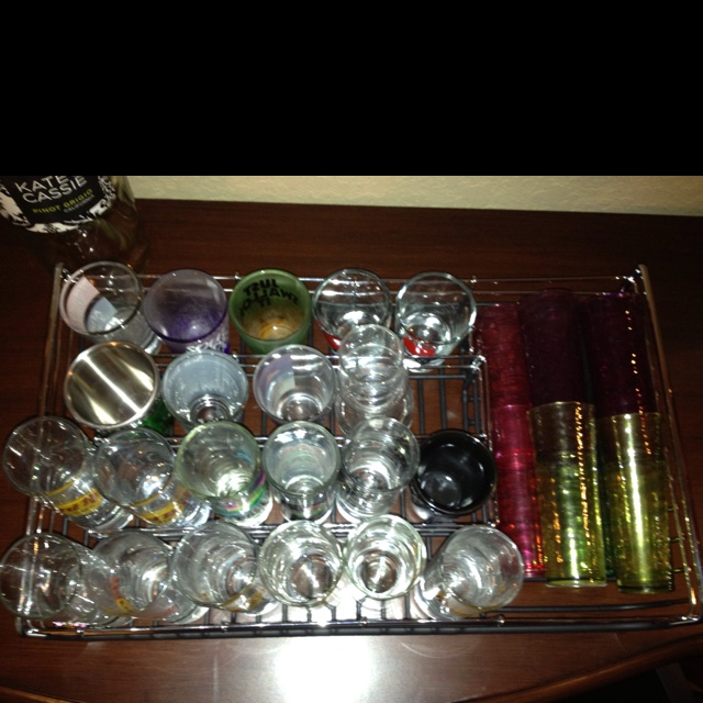 Need a way to organize shot glasses? Buy a kitchen shelf organizer!