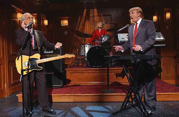 LIVE Episode 16 Air Date Pictured Fred Armisen as George Ross Amy Poehler as Carolyn Kepcher Donald Trump during 'The Apprentice Band' skit on April...