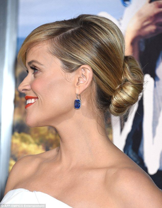Stunning: Reese kept things simple with a pair of nude court shoes, while wearing her glossy locks styled into an elegant updo as she highlighted her gorgeous complexion with a generous slick of red lipstick and lashings of mascara